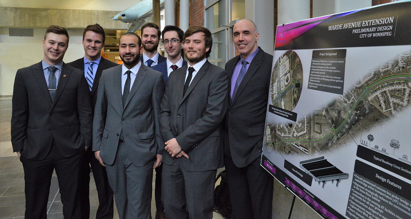 Matthew Allen and 2019 Capstone Design Team next to Project Poster with overview