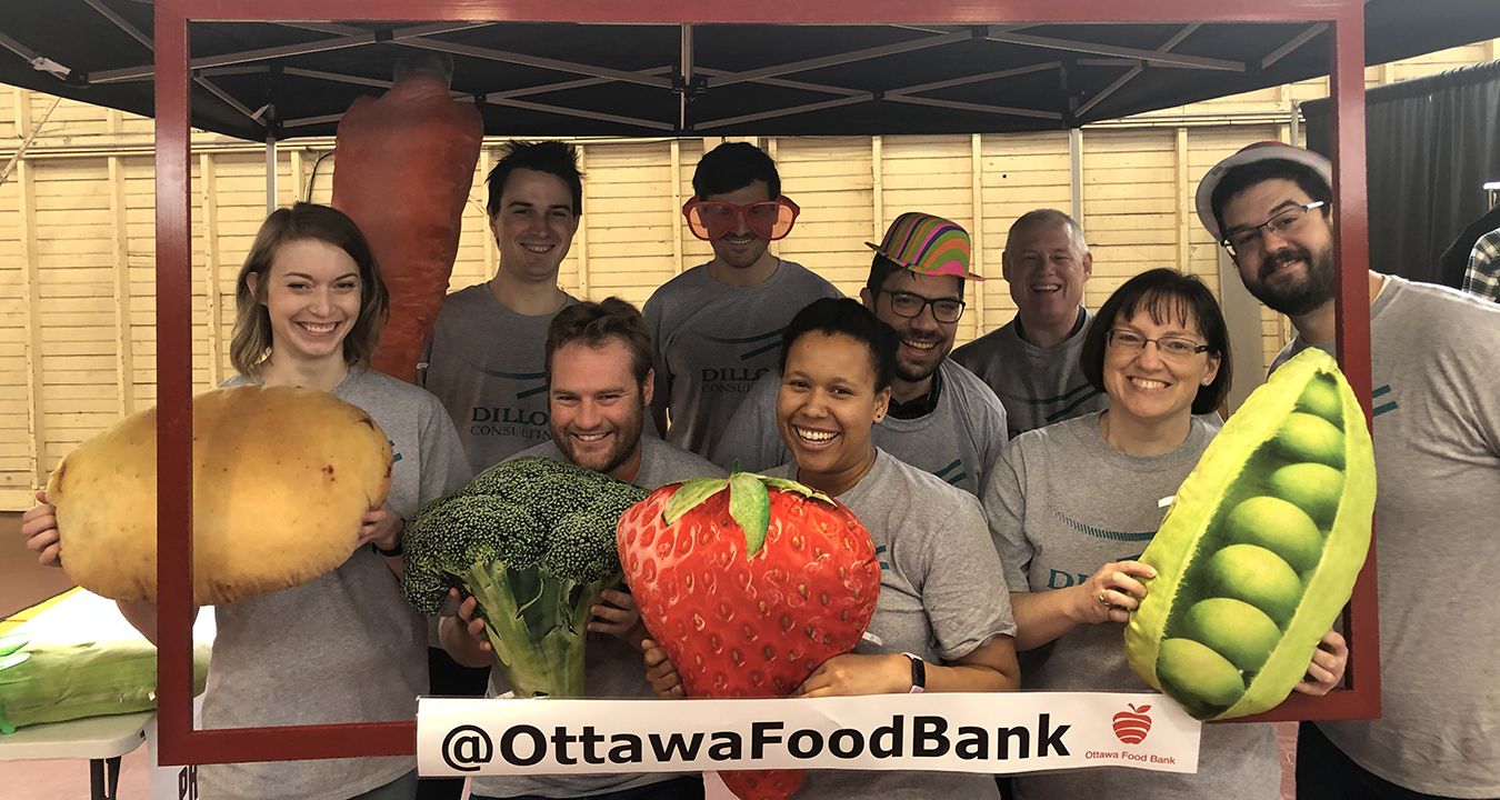 "9 Dillon people holding stuffed over-large vegetables inside a frame named ""@OttawaFoodBank"""
